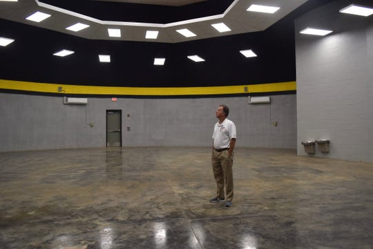 Mike Papas, Forrest County School District auxiliary services director, looks at the ceiling of Dixie Attendance Center's safe room.