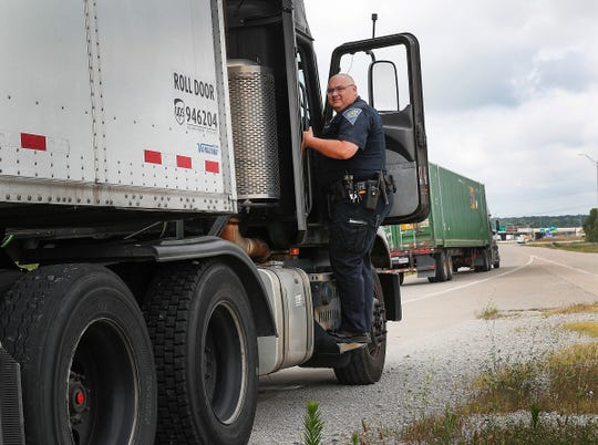 Indiana State Police Senior Trooper Brent Hoover performs a traffic stop on a vehicle along I-70 during a ISP large scale enforcement detail to stop and warn drivers who are driving reckless and aggressive drivers Tuesday, July 16, 2019.