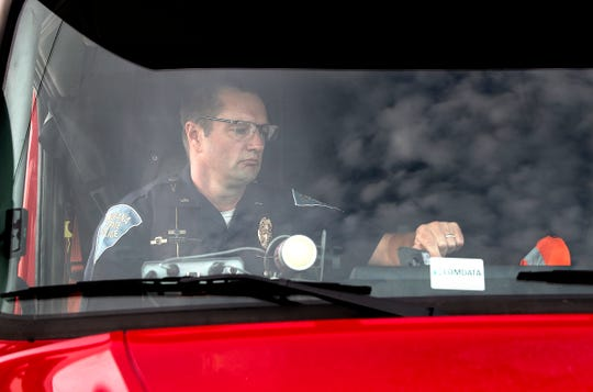 Indiana State Police Lt. Tyler Utterback gets settled in his seat in the semi truck during a ISP large scale enforcement detail to stop and warn drivers who are driving reckless and aggressive drivers Tuesday, July 16, 2019.