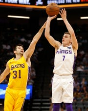 Kings guard Kyle Guy, right, goes up for the shot against Lakers guard Dakota Mathias in a summer league game in Sacramento, July 3, 2019.
