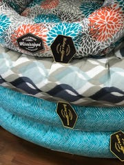 Hollywood Feed stocks a line of dog beds that are stitched in Tupelo.