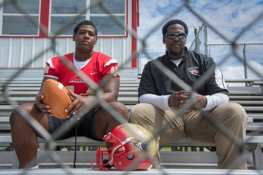 Montra Edwards Jr., of Lexington, sits with his father, Montra Edwards Sr. The son is a 6-foot-3, 290-pound, defensive lineman at Holmes County Central High.