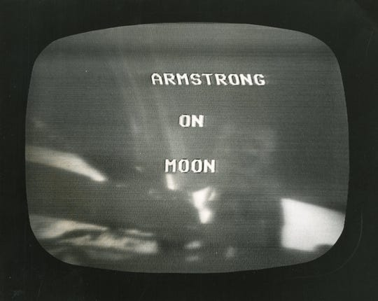 """A television set with the words """"Armstrong on Moon"""" on July 21, 1969."""