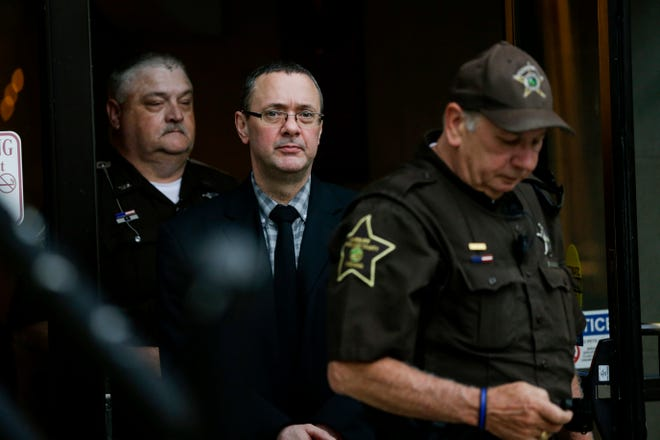 Patrick Elliott is escorted out the Tippecanoe County Courthouse by sheriff's deputies after day two of trial, Tuesday, July 16, 2019 in Lafayette. Elliott, 50, is accused of killing his wife on Aug. 8, 2017.