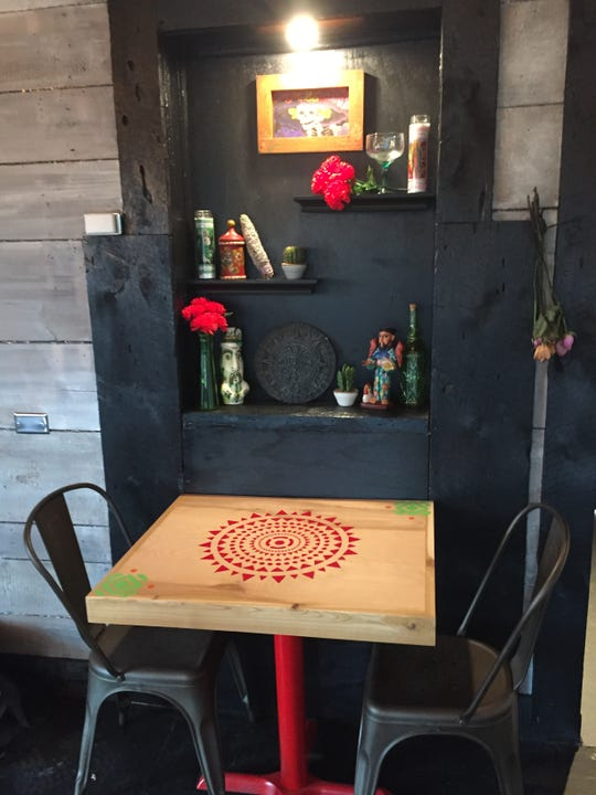 Decor inside El Àrbol in downtown Brighton, shown Tuesday, July 16, 2019, is Mexican-themed to match the Mexican street food-inspired menu.