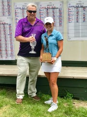 Dave Wigton presents the Wigton Family crystal trophy to overall Ohio Junior Girls Championship winner Kristin Jamieson of Hillsboro who shot a 6-under-par 138.