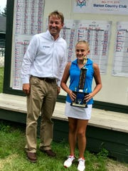 Scott Knowles of Sims Brothers presents 13-and-under champion Gianna Clemente of Warren with the trophy at Tuesday's final round of the 43rd annual Ohio Junior Girls Championship at Marion Country Club.