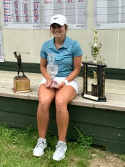 Ohio Junior Girls Championship winner Kristin Jamieson of Hillsboro shot a 6-under-par 138. Jamieson, posing with her trophies earned Tuesday at Marion Country Club, will compete at Ohio State in the fall.