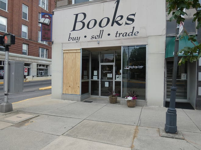 A bullet hit and shattered a window early Saturday at Books on Center on West Center Street.