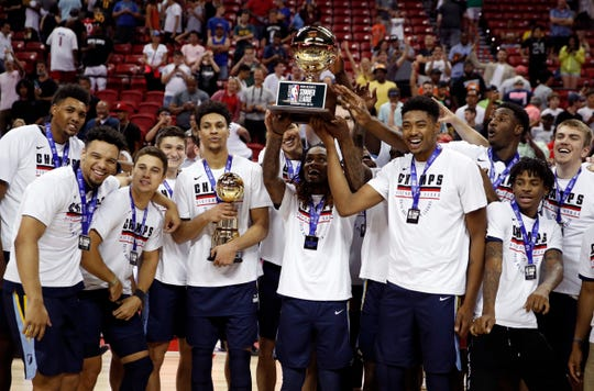 Grizzlies players pose for photographers after defeating the Timberwolves in an NBA summer league championship game Monday in Las Vegas.