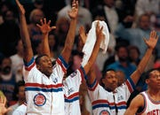 William Bedford, left, and the Detroit Pistons bench celebrate in the closing minutes of Game 1 of the 1990 NBA Finals against the Portland Trail Blazers.