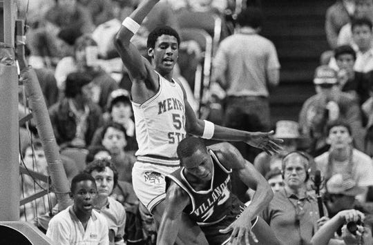 Memphis State's William Bedford (50) defends Villanova's Dwayne McClain (33) in the 1985 Final Four.