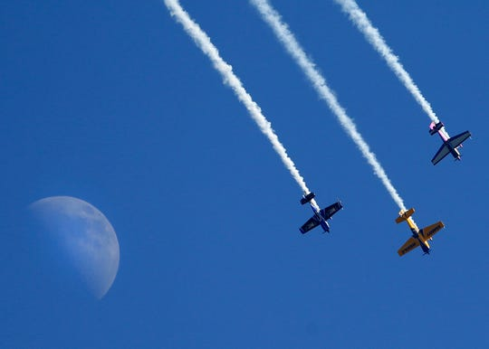 Pilots perform at EAA AirVenture in Oshkosh. The weeklong aviation convention and fly-in starts Monday.