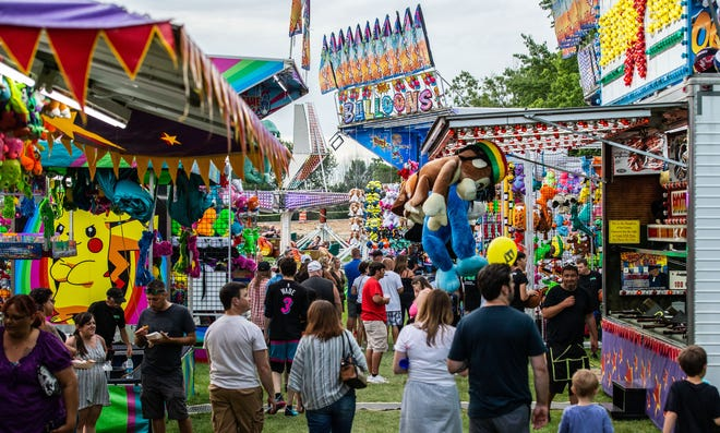 Festival-goers enjoy the midway during the 52nd annual Sussex Lions Daze on Saturday, July 13, 2019. The three-day festival features live music, carnival rides, arcade games, fireworks, food, refreshments and more. The 2020 festival was canceled for July 10-12 due to COVID-19, but is planning to be back in 2021.