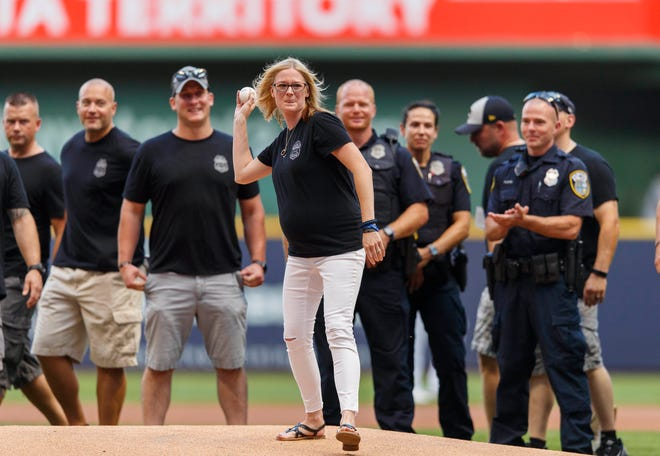 Caroline Rittner throws out the first pitch before Monday's game between the Atlanta Braves and Milwaukee Brewers at Miller Park. Caroline Rittner is the wife of fallen Milwaukee Police Officer Matthew Rittner.