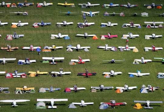 Pilots camp next to their planes at EAA AirVenture in Oshkosh. More than 10,000 planes come to AirVenture each year. The week-long convention begins Monday.