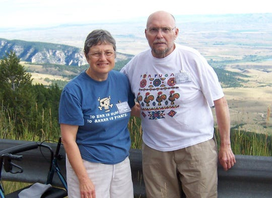 Sue and Jim Machan pose for a photo at Yellowstone National Park in 2010. Their son Derek Machan said it was the last trip his parents were able to take before Jim was given orders not to be on his feet. A GoFundMe campaign to buy a tandem wheelchair bicycle Jim can ride has raised more than $15,000.