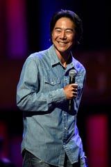 Comedian Henry Cho during a performance at the Grand Ole Opry in Nashville, Tenn.