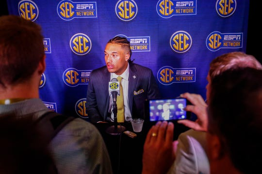 Texas A&M quarterback Kellen Mond speaks to reporters during the NCAA college football Southeastern Conference Media Days, Tuesday, July 16, 2019, in Hoover, Ala. (AP Photo/Butch Dill)