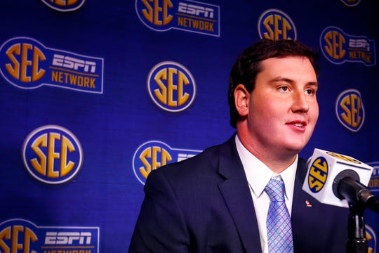 Mississippi offensive lineman Alex Givens speaks to reporters during the NCAA college football Southeastern Conference Media Days, Tuesday, July 16, 2019, in Hoover, Ala. (AP Photo/Butch Dill)