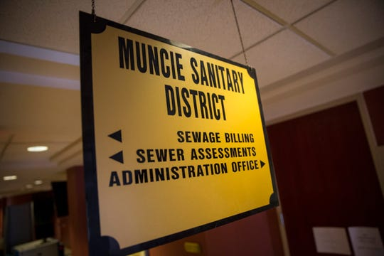 FROM JULY: Signs on the Muncie Sanitary District administration office and sewage utility office note that they are closed during the FBI investigation. The FBI also arrested the district administrator of the Muncie Sanitary District and a local businessman during the raid