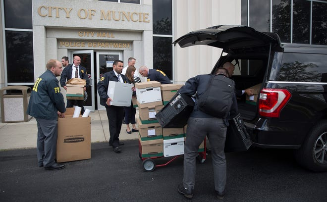 Agents and support staff with the FBI on July 16, 2019, carry out documents and computers from Muncie City Hall after raiding two Muncie Sanitary District offices.