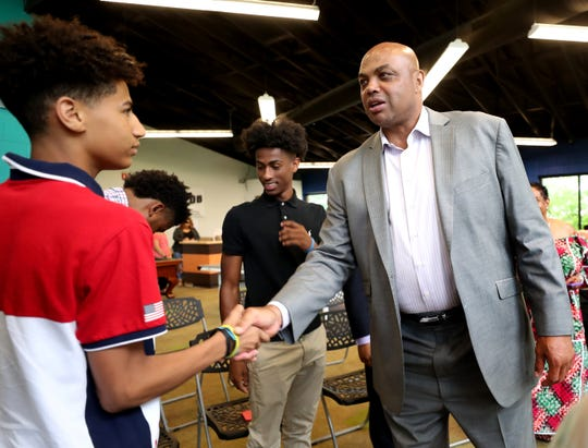 Charles Barkley shakes hands with Alexis Dean,15 before Barkely speaks at the Boys & Girls Clubs of Rutherford County in Murfreesboro before the 32nd Annual Stake & Burger event at MTSU on Tuesday, July 16, 2019.