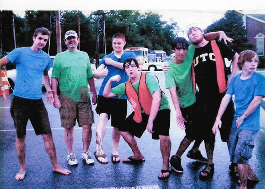 Bethlehem United Methodist Church Fish Fry goers James Kessel, David McQuiddy, Miles McNulty, Ben McQuiddy, Chandler Klinck, Matt McQuiddy and Neal McIntyre brave the rain about 10 years ago at the event. The day marked the only day it rained at the event in 45 years, according to David McQuiddy.