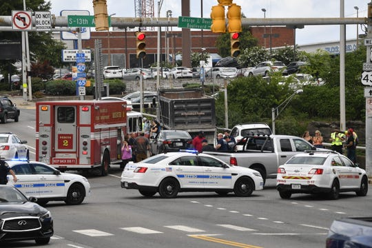 Traffic backed up after part of Broadway was closed in both directions following a fatal collision between a dump truck and a pedestrian Tuesday at the intersection of 13th Avenue S. and Broadway in downtown Nashville.