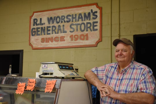 Worsham's Market owner Bobby Worsham received a $50,000 check after his store sold the winning Powerball ticket.