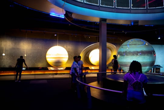 Children look at planets at Adventure Science Center on Tuesday in Nashville.