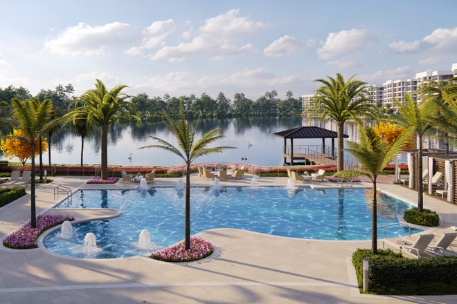 The resort-style pool with poolside cabanas overlook the Life Plan community's 28-acre lake.