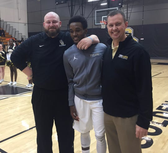 Peghuentz Pericles, center, is flanked by Golden Gate coaches Guy Hensley, left, and Greg Anderson during Pericles' senior 2015-16 season with the Titans. Pericles has been reunited with Hensley at Division II Tiffin University in Ohio, transferring from Upper Iowa University in the offseason.