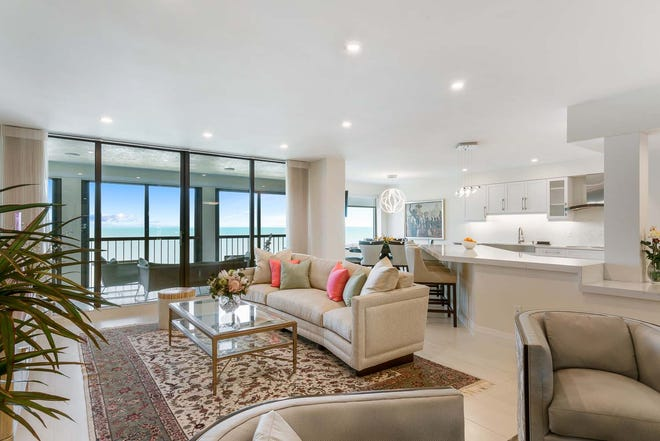 AFTER: A Bay Colony condo renovation adds brightness by opening up living areas.