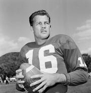 In this Sept. 9, 1958 file photo, New York Giants halfback Frank Gifford participates in a workout in New York. In a statement released by NBC News on Sunday, Aug. 9, 2015, his family said Gifford died suddenly at his Connecticut home of natural causes that morning. (AP Photo/John Rooney, File)