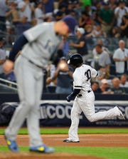 New York Yankees designated hitter Edwin Encarnacion (30) rounds the bases after hitting a home run against Tampa Bay Rays starting pitcher Blake Snell (4) in the fourth inning at Yankee Stadium.