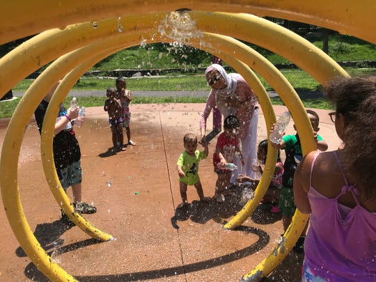 The splash pad at Passaic's Third Ward Park was in heavy use Tuesday afternoon as temperatures rose into the 90s.  The pad was not operational because of equipment problems but came back on line last week.