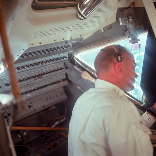 This July 20, 1969 photo made available by NASA shows Apollo 11 astronaut Buzz Aldrin in the Lunar Module cabin during the translunar coast.