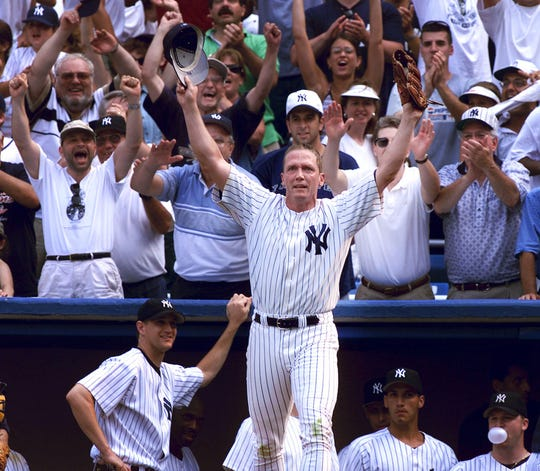 New York Yankees pitcher David Cone takes a curtain call after pitching a perfect game against the Montreal Expos at Yankee Stadium in New York, Sunday, July 18, 1999.  (AP Photo/Jeff Zelevansky)