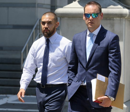Former Paterson Police Officer, Frank Toledo, left, and his attorney Dennis Cleary leave the Federal Courthouse in Newark on July 16, 2019 after being charged in court.