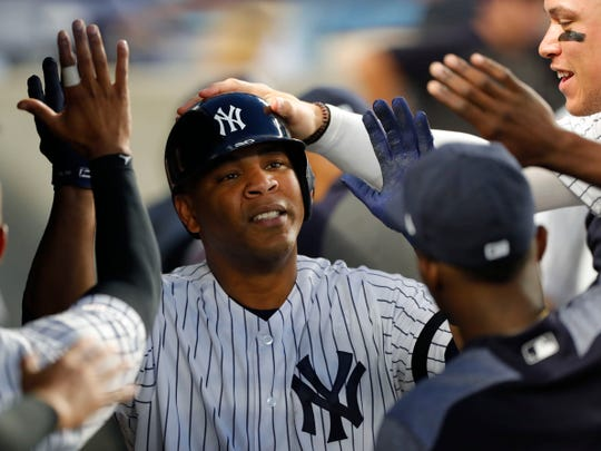 New York Yankees designated hitter Edwin Encarnacion (30) celebrates in the dugout with teammates after hitting a home run against the Tampa Bay Rays in the fourth inning at Yankee Stadium.
