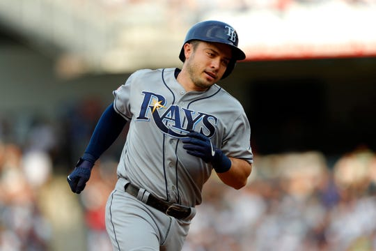 Tampa Bay Rays catcher Travis d'Arnaud (37) rounds the bases after hitting a home run against the New York Yankees in the first inning at Yankee Stadium.
