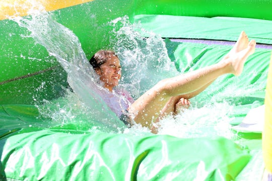 The giant water slide cooled off children during the City of Deming Summer Youth Recreational Program.