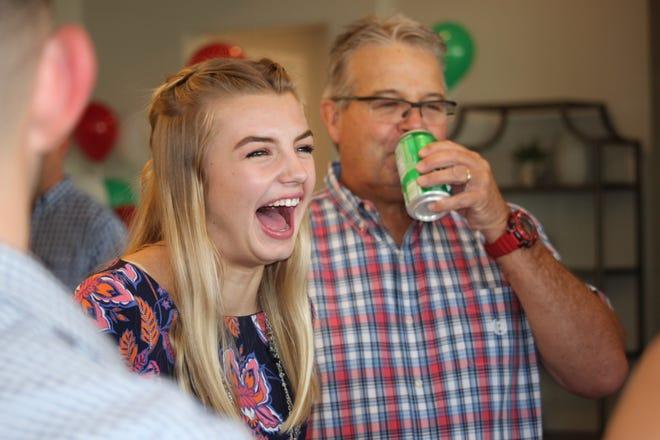 Annika Conn, 17, smiles and laughs after she hears the news that she and her family will be going on trip to Italy thanks to the Make-A-Wish Foundation New Mexico. Conn has been battling with cystic fibrosis since she was 5-years-old.