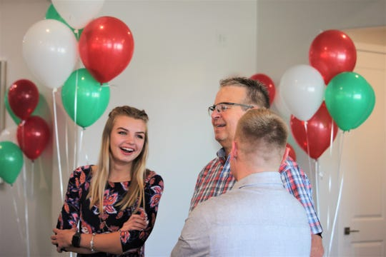 Annika Conn, 17, stands with her father, Tim Conn, after she was surprised with a trip to Italy thanks to the Make-A-Wish Foundation New Mexico.