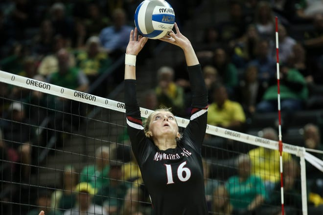 New Mexico State sophomore Natalie Mikels sets the ball during a 2018 match.  (Eric Evans Photography)