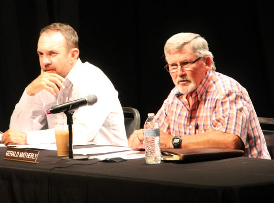Otero County Commission Chairman Couy Griffin, left, and Otero County Comission Vice-Chairman Gerald Matherly at a public hearing at the Flickinger Center discussion the county's Hemp Production Ordinance. Otero County Commissioner Lori Bies was absent from the public hearing due to illness.