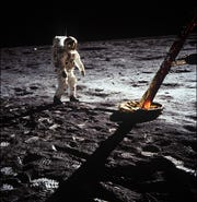"Astronaut Edwin ""Buzz"" Aldrin walks on the surface of the moon near a leg of the lunar module during the Apollo 11 mission on July 20, 1969, while being photographed by mission Commander Neil Armstrong."