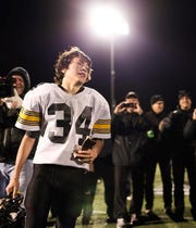 Drew Poet grasps his Super Bowl trophy  following his final game as a Plymouth-Canton Steeler in 2015.