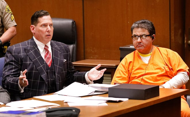 Naason Joaquin Garcia, the leader of a Mexico-based evangelical church with a worldwide membership, appears with his defense attorneys Ken Rosenfeld, left, and Allen Sawyer for a bail review hearing in Los Angeles Superior Court on Monday, July 15, 2019. Prosecutors have asked a judge to hold Garcia without bail on charges of child rape and human trafficking. (Al Seib/Los Angeles Times via AP, Pool)